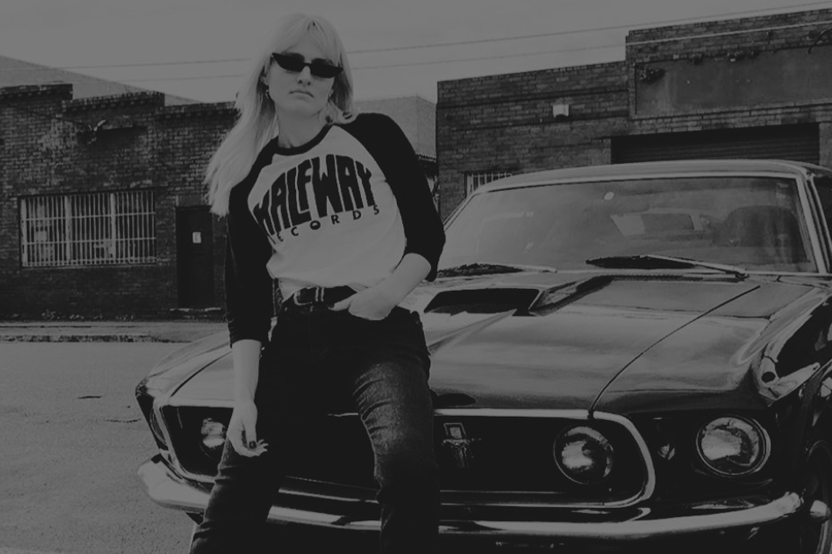 Beautiful girl with a Half Way Records tshirt and a car behind her