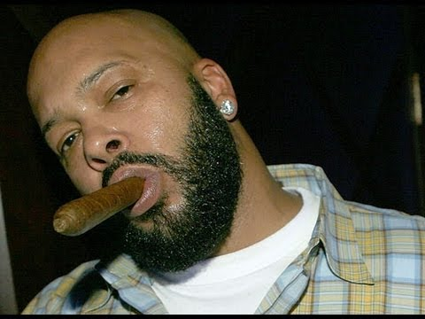 Marion HughSuge Knight Jr smoking a sigar