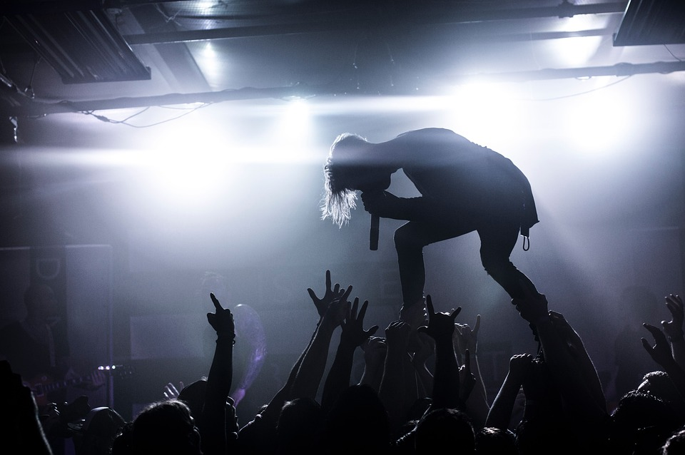 book live music gigs with singer screaming on top of the crowd from the stage