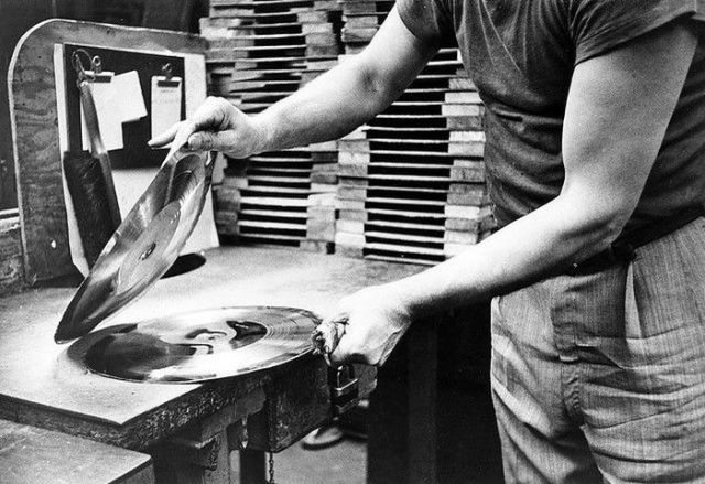 man working at a vinyl pressing plant