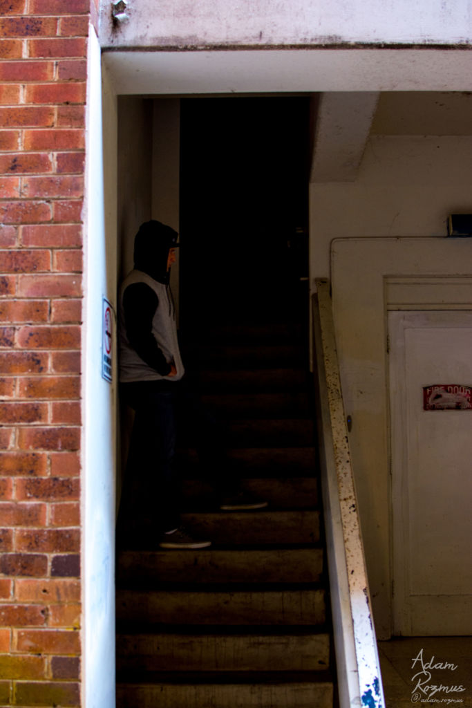 HMO standing on a stair