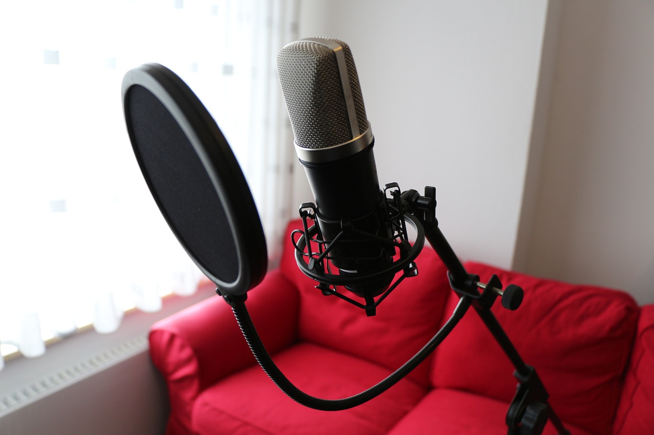 condenser microphone with a red sofa behind