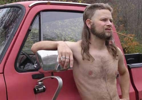 musicians redneck smoking in front of red van