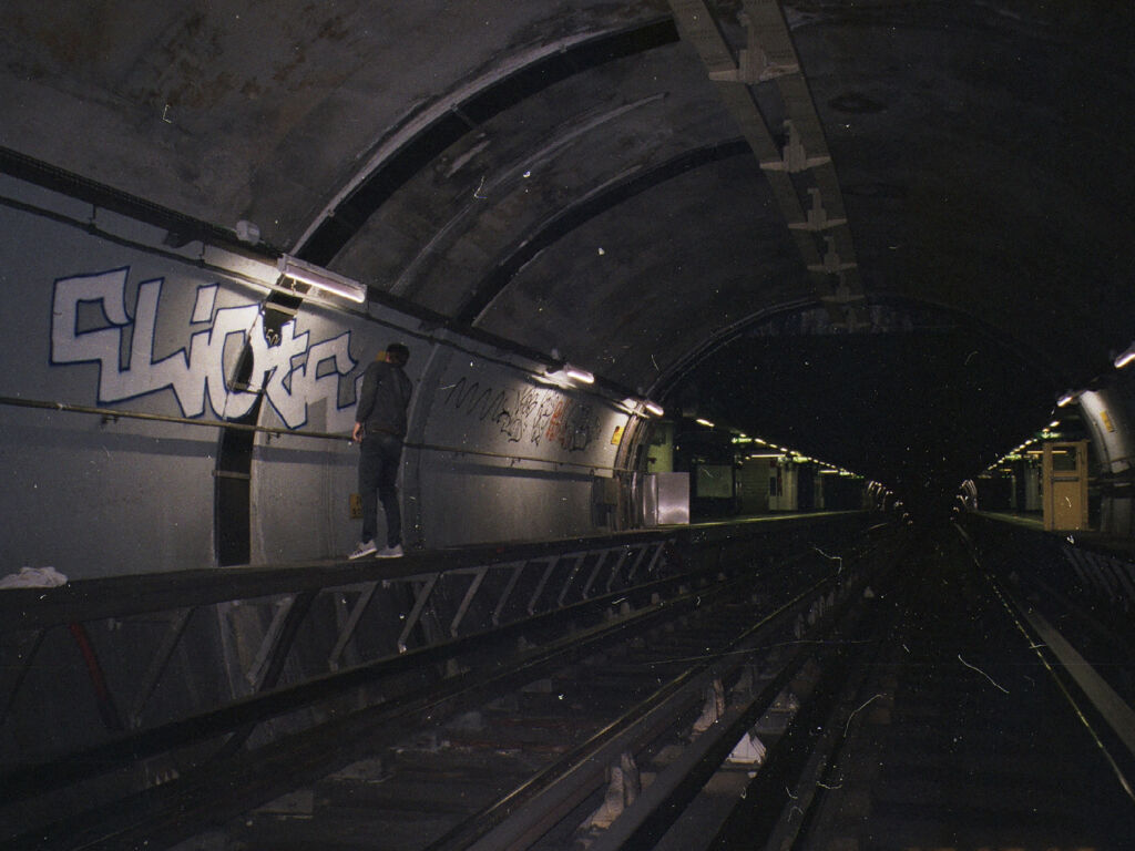 eliote painting in a tunnel