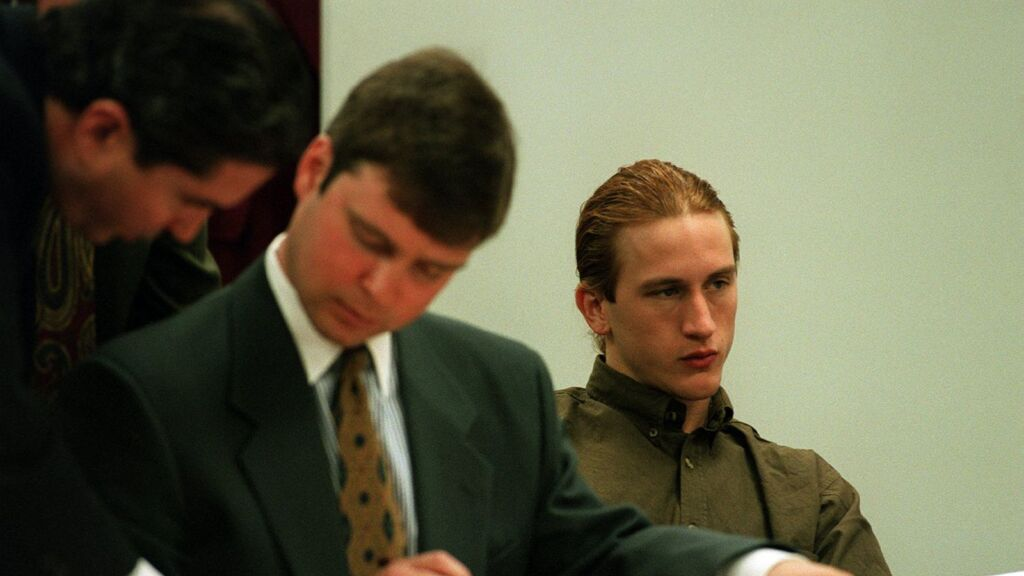 Mike Diana and his attorneys sit in court (1994)